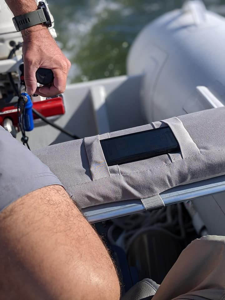 One of the innovative improvements Barbara made to our sailing lifestyle was a new dinghy cushion with an integrated phone pocket so I could use it to navigate while keeping both hands free. Awesome!